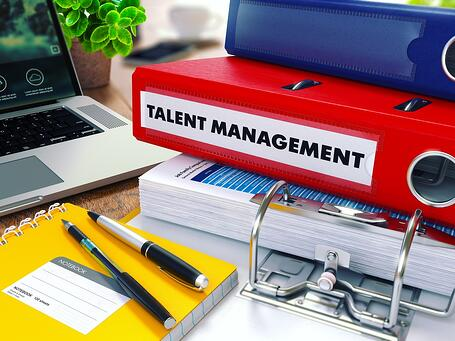 Talent Management - Red Ring Binder on Office Desktop with Office Supplies and Modern Laptop. Business Concept on Blurred Background. Toned Illustration..jpeg
